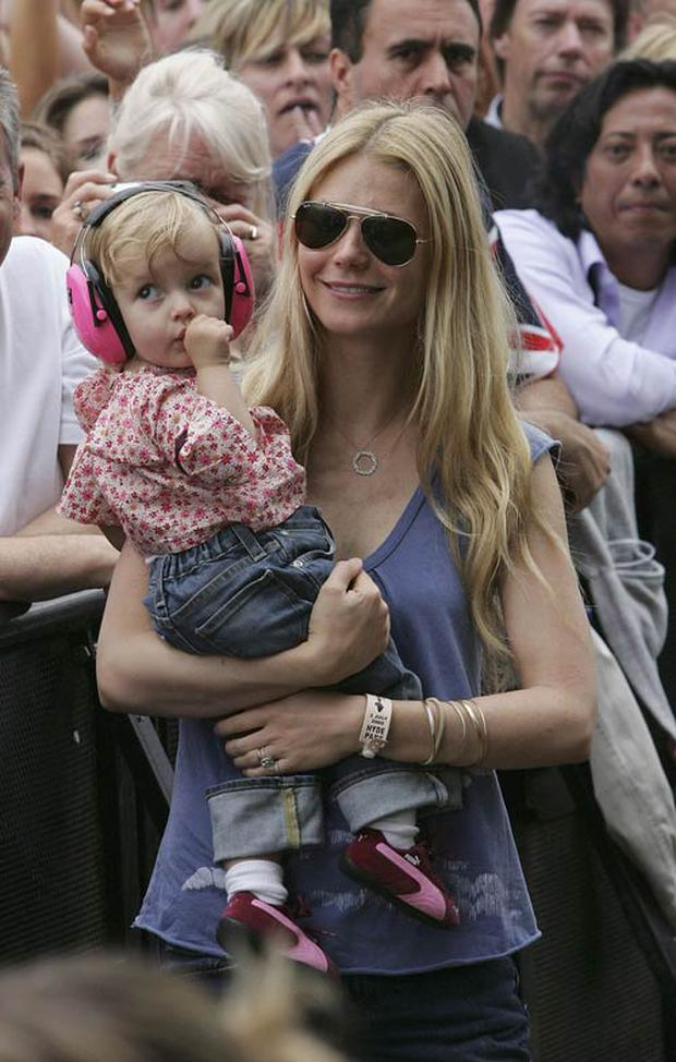 Gwyneth Paltrow with daughter Apple at a London concert in 2005.