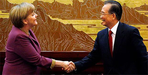 German Chancellor Angela Merkel shakes hands with Chinese Premier Wen Jiabao