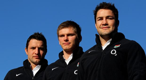 England debut caps Phil Dowson, Owen Farrell and Brad Barritt pose for the camera during the England press conference. Photo: Getty Images