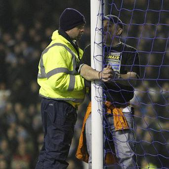 A Premier League match was brought to a standstill when a man handcuffed himself to a goalpost