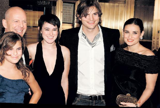 Bruce Willis and his ex-wife Demi Moore with their children Rumer and Tallulah and Ashton Kutcher