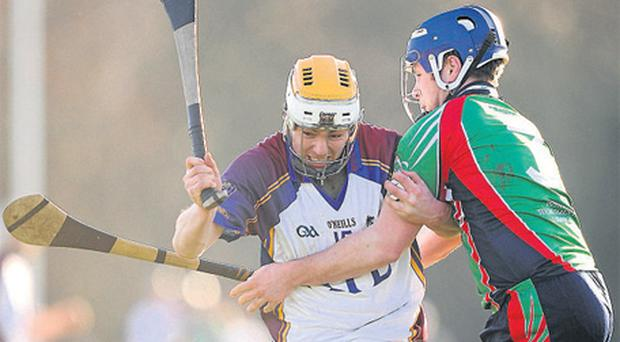 Conor McGrath tries to get past Richie McCarty during the Fitzgibbon Cup match at the University of Limerick yesterday