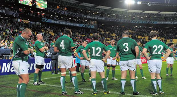 The Irish players show their dejection after losing their World Cup 2011 quarter-final showdown with Wales in Wellington last October