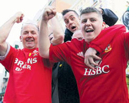 Welsh rugby fans John Phillips, Carl Baldwin and Jamie Murphy in Dublin last night ahead of tomorrow's opening Six Nations match between Ireland and Wales at the Aviva Stadium.