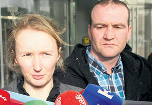 Siobhan Cummiskey, solicitor for the Irish Traveller Movement with John Stokes, the boy's father