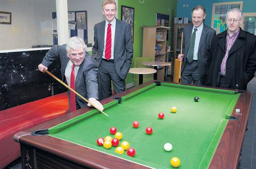 Tanaiste Eamon Gilmore and Derek Nolan TD (second from left) enjoy a game of pool yesterday at Jigsaw Galway, a youth mental health centre in the city.