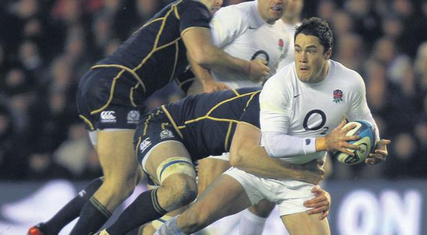 England's Brad Barritt is hauled down during the RBS 6 Nations match against Scotland at Murrayfield yesterday