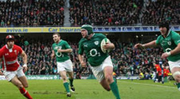 Ireland's Rory Best races clear to score a try