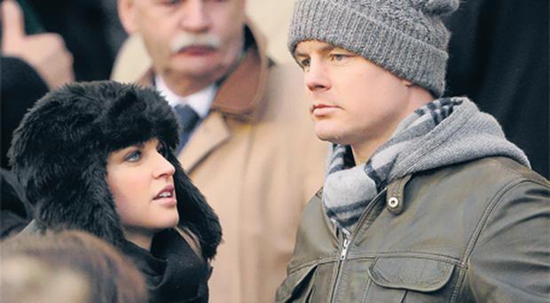 Injured Ireland rugby star Brian O'Driscoll and his wife Amy Huberman at yesterday's match during which Wales snatched a last-minute winning penalty