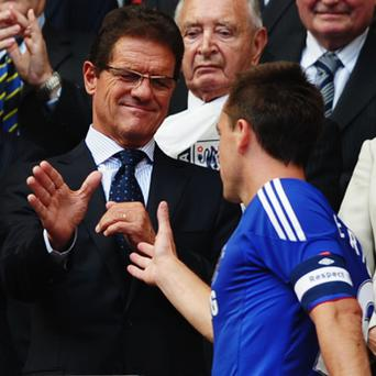Backing his man: England manager Fabio Capello with axed captain John Terry. Photo: Getty Images