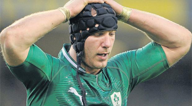 Stephen Ferris holds his head in his hands after conceding a late penalty and yellow card to set up a Wales' two-point Six Nations victory at Lansdowne Road