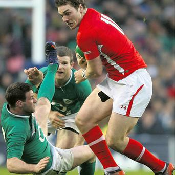 Wales' George North bulldozes his way passed Fergus McFadden