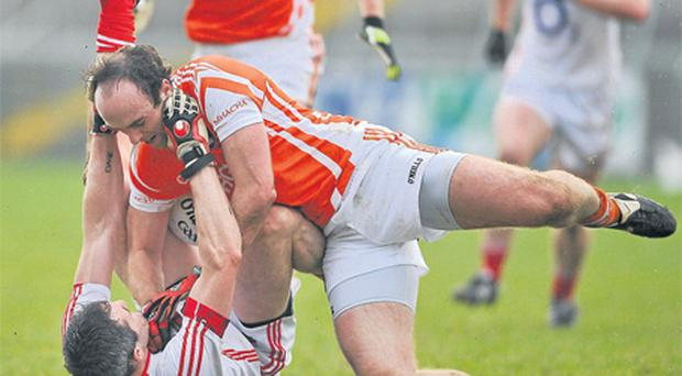 Cork's Graham Canty is grounded by Arnagh's Malachy Mackin as the pair get tangled up yesterday