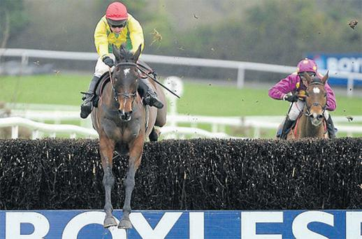 Sizing Europe, with Andrew Lynch up, leads Big Zeb over the last on the way to landing the Boylesports.com Tied Cottage Chase at Punchestown yesterday