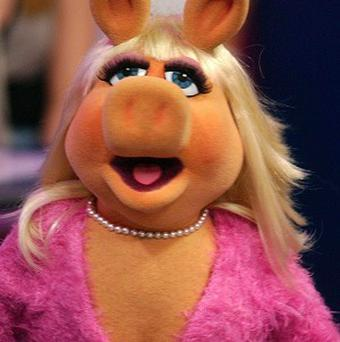 The glamorous star of The Muppets, Miss Piggy, is set to get up close and personal with George Clooney and Brad Pitt as she hosts the Bafta Awards