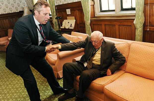 Ian Paisley with his son Ian Paisley Jnr after the former Northern Ireland First Minister took his seat in the House of Lords as Lord Bannside in May 2010