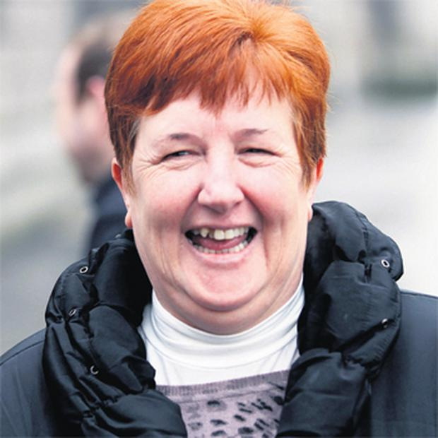 Sandra Memery leaving court in Dublin yesterday after settling her case against Fianna Fail and Executive Posters Ltd.
