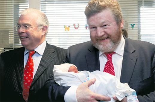 Peter Mathews TD and Health Minister James Reilly with newborn Alex Kavanagh during a tour of Mount Carmel Hospital in Dublin yesterday