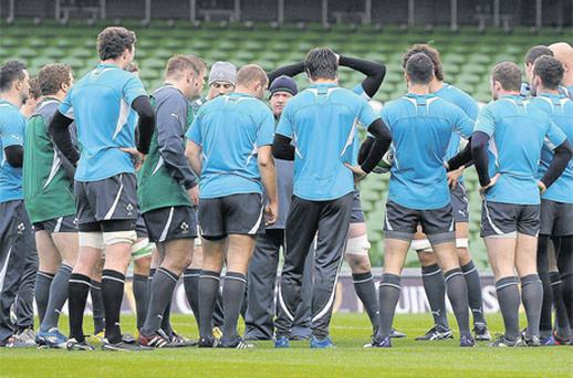 Ireland's head coach Declan Kidney speaks to his players prior to their game against Wales last weekend. The manager and several players are under the spotlight after the opening Six Nations defeat