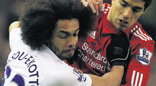 Luis Suarez, seen here battling for possession with Benoit Assou-Ekotto, returned to action after suspension last night