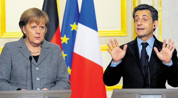 French President Nicolas Sarkozy and German Chancellor Angela Merkel attend a news conference at the Elysee Palace in Paris, yesterday following a Franco-German intergovernmental meeting. Photo: Reuters