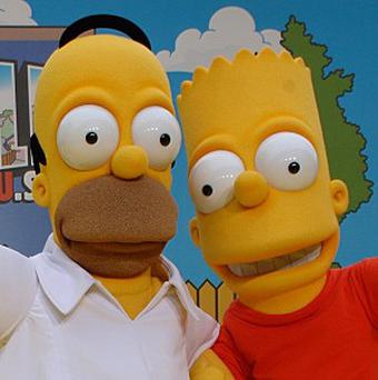 Dolls depicting Homer, Bart and the rest of the Simpson clan have been banned in Iran, a newspaper has reported