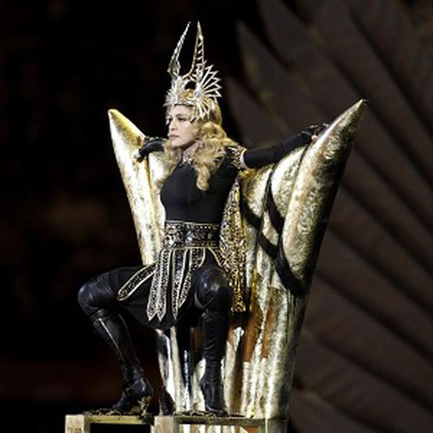 Madonna performs during half time at the Super Bowl