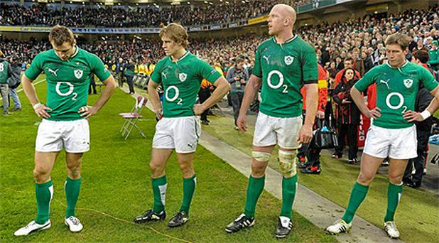 Ireland players on the pitch at the Aviva following the defeat to Wales