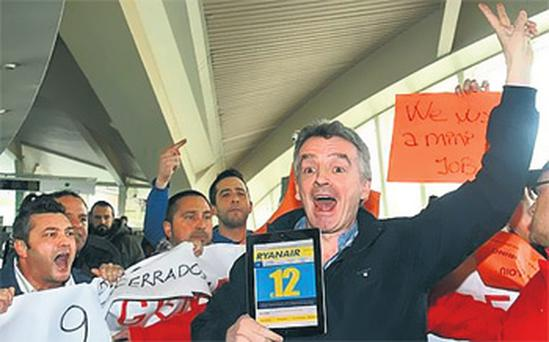 Ryanair chief Michael O'Leary was surrounded by angry airline workers at Bilbao Airport in Spain yesterday