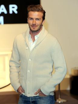 David Beckham arrives at the H&M store on Regent Street, London to launch his new Bodywear collection. PRESS ASSOCIATION Photo. Picture date: Wednesday February 1, 2012. Photo credit should read: Anthony Devlin/PA Wire