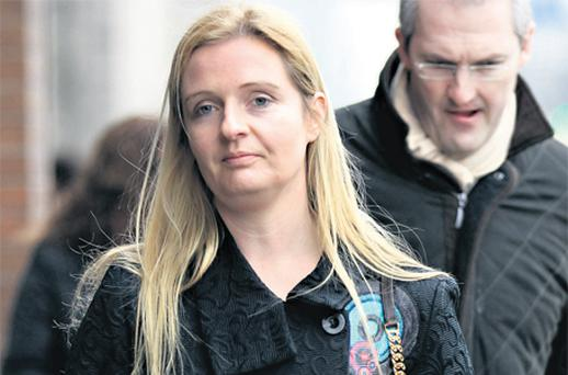 Sean Quinn's daughter Ciara leaving the Commercial Court hearing in Dublin yesterday. The case was adjourned until the end of the month when Mr Justice Peter Charleton will give his judgment. Photo: Courtpix
