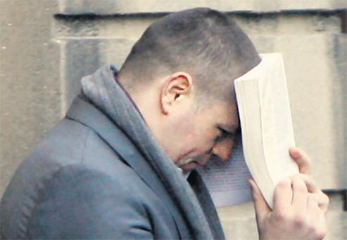 Paul McMenamy outside court yesterday, where he was charged with assaulting Nicola Murray
