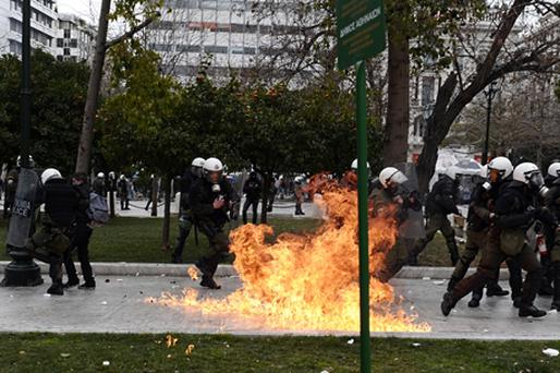 A protester clashes with riot police during a 48-hour general strike in Athens. Photo: Getty Images
