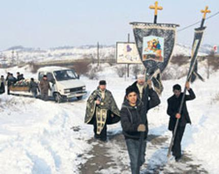 the funeral cortege at Marioara Rostas's funeral in Tileagd, Romania, yesterday