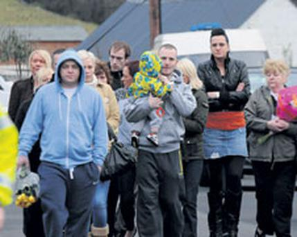 family and friends arrive in Buncrana to lay flowers at the scene of Andy Allen's killing