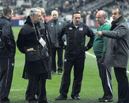 GAME OFF: From right, France coach Philippe Saint Andre, Ireland coach Declan Kidney and referee Dave Pearson