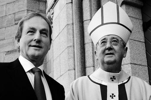 DIVIDE: Archbishop Diarmuid Martin with Taoiseach Enda Kenny. Photo: Steve Humphreys