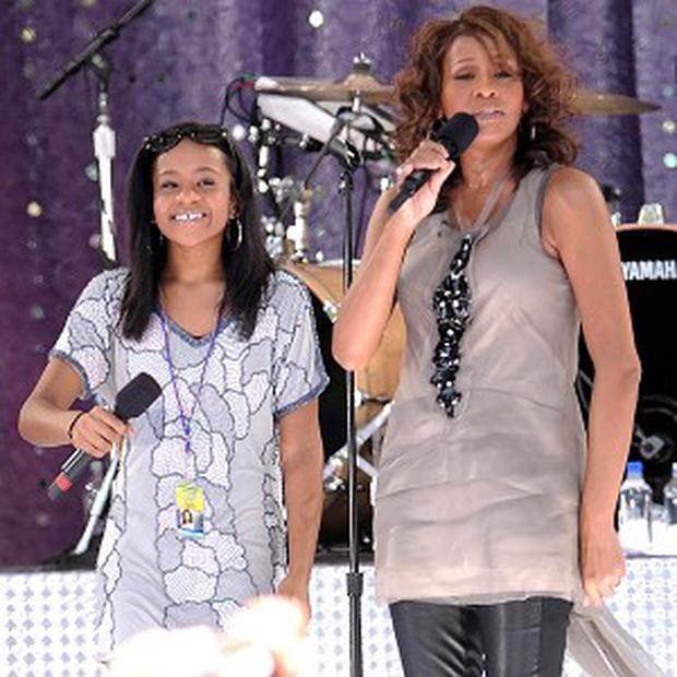 Whitney Houston's daughter Bobbi Kristina Brown has been taken to hospital the day after her mother's death