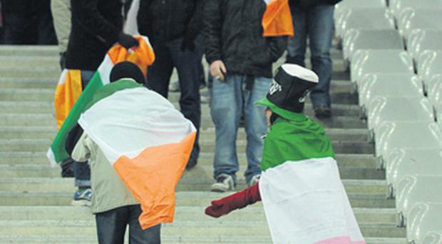 Ireland supporters leave the stadium after the game was called off