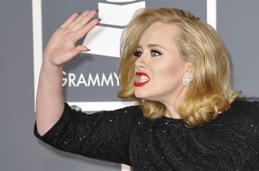 Adele poses on the red carpet at the Staples Center . Photo: Getty Images