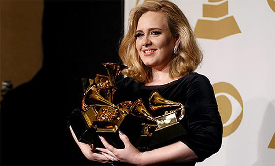 Adele shows off her six Grammy awards