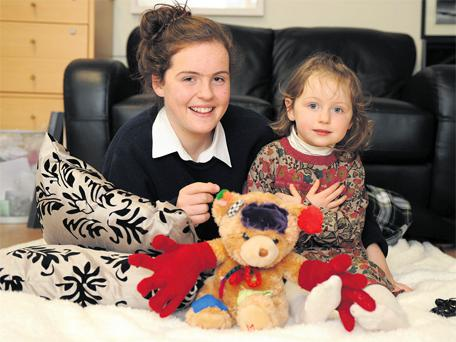 Katie McCarthy and her sister Aoibheann with the prototype teddy Deaffie Eddie Freddie