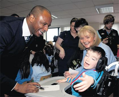 Football star Patrick Vieira with Aaron Maher from Nenagh, Co Tipperary, at St Gabriel's school for children with disabilities in Dooradoyle, Limerick, yesterday
