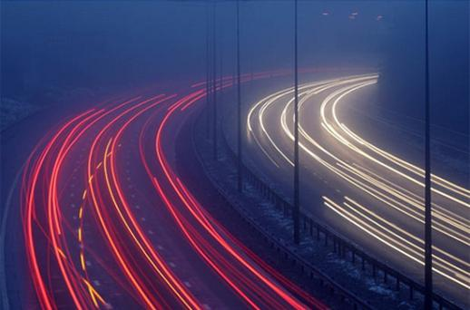 Traffic makes its way along the M1 motorway in freezing fog. Photo: Getty Images