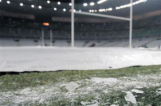 The protective covering fails to prevent the Stade de France pitch from the freezing conditions which caused Ireland's game with France to be postponed