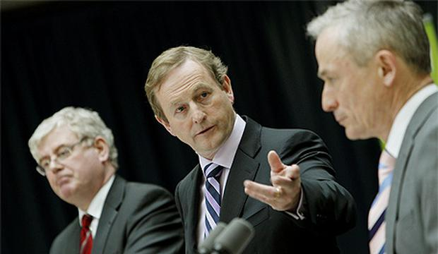 Taoiseach Enda Kenny with Tanaiste Eamon Gilmore (left) and Minister for Jobs, Enterprise and Innovation Richard Bruton at the announcement by the Government of the Action Plan for Jobs