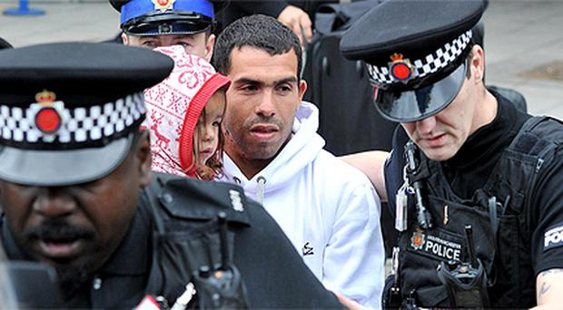 Carlos Tevez arrives at Manchester Airport