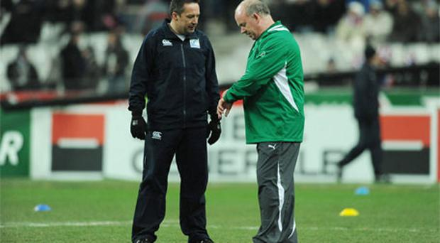Ireland head coach Declan Kidney speaking with referee Dave Pearson before the game was scheduled to kick- off. Photo: Sportsfile