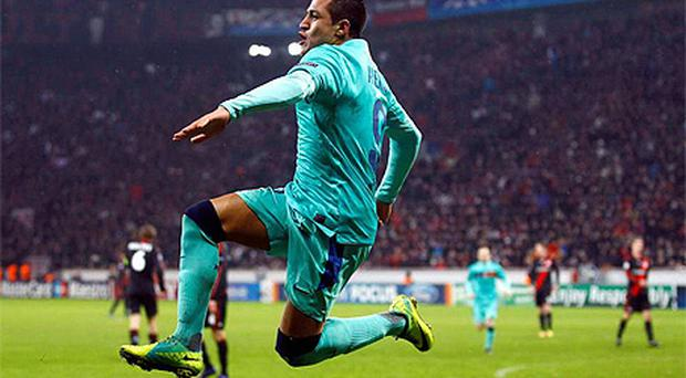 Alexis Sanchez of Barcelona celebrates his first goal against Bayer Leverkusen last night