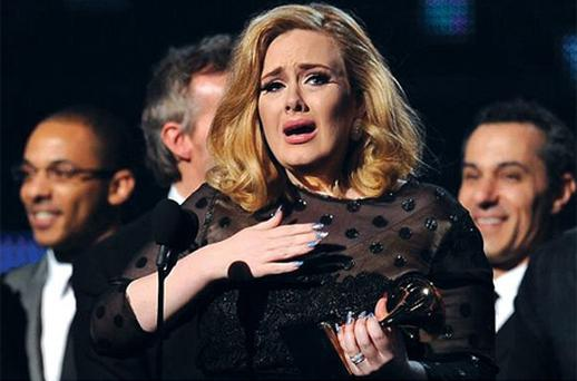 Adele cries as she accepts her Grammy for Album of the Year. Photo: Getty Images